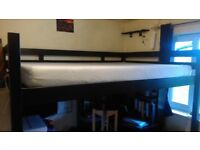 Amazing Space saving Double bed. It's a Loft bed - An IKEA STORA Loft Bed.