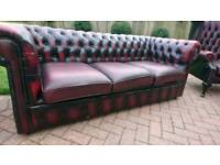 An ox blood red leather Chesterfield 3 seater sofa