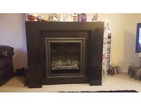 Electric fire with black marble look surround