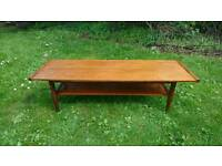 A lovely vintage retro teak table with magazine rack from around 1970