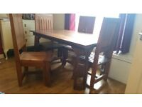 Unique and very heavy, solid reclaimed hard wood dining table and 4 chairs.