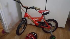 """Boys 14"""" red and black raleigh bike with helmet"""