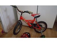 "Boys 14"" red and black raleigh bike with helmet"