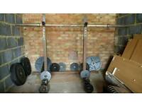 7ft Olympic bar, squat rack, 107.5kg of weights, and 5kg collars