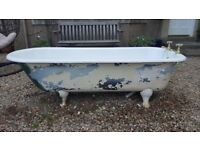 Roll top cast iron bath with feet and taps