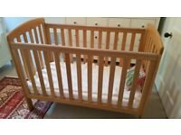 Solid oak Mamas and Papas cot for sale with sprung mattress