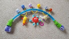 Taff toys clip on activity arch with rattle and jingle toys