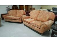 Terracotta 2 x2 seater sofas on brass casters in good condition can deliver