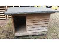Medium/large wooden dog kennel with removable sloping mineral felt roof.