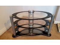 Glass TV stand, good condition. Buyer collects