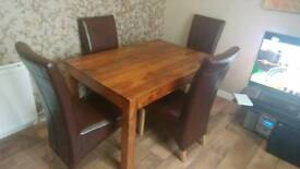 Very nice table with 4 chairs