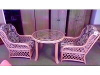 EXCELLENT CONDITION!!! Set of two cane/ wicker chairs and glass topped wicker/ cane table