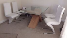 Glass top dining table and 4 Free Faux Leather White leather chairs