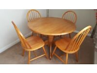 Solid wood pedestal dining table and 4 chairs, ex Ikea