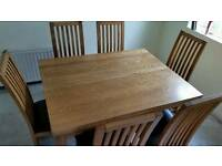 Solid oak dining table and chairs.