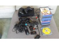 PLAYSTATION 2 CONSOL ASSESORIES AND 18 GAMES