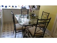 Glass dining table and 4 chairs in Bournemouth Eastcliffe