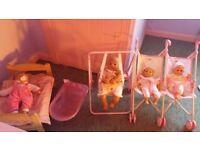 Dolls bed , swing, twin buggy , bath