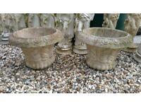 2 stone flower planters