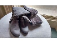 Fur lined grey boots . Wear over knee or with turn down. Never worn. Size 6