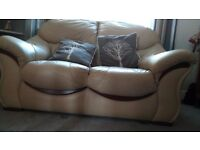 cream leather 2 seater sofa with 2 chairs