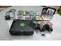 XBOX plus controllers, steering wheel, pedal box and games