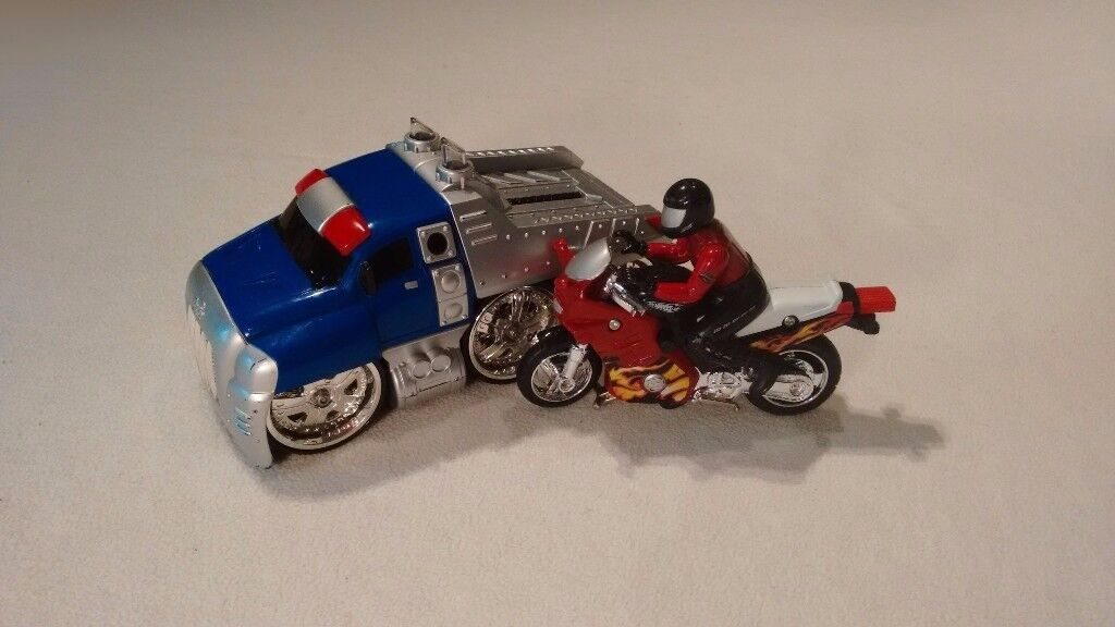 Metal Vehicles- truck and a motorcycle.