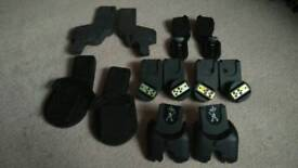 Selection of car seat adapters, maxi cosi to pram, pushchairs