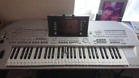 TYROS 2 GOOD CONDITION,STICKERS PEEL OFF,WITH STAND