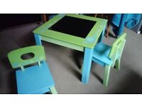 Table and 2 Chairs. Great condition. Early Learning Centre. Blackboard top.