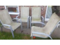 Large heavy glass top garden tabel and 4 chairs