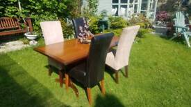 Solid Wood Dining Table with Leather and Suede Chairs