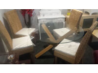 Glass/wood dining table & 4 wicker dining chairs