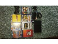 Playstation 2 slimline with wireless controller memory card and 6 games £30