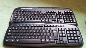 Two Logitech Keyboards and Mice