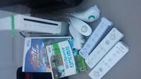 wii console, remotes, chucks and 2 games