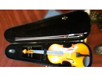 Two violins in cases with bows