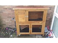 Double rabbit hutch only 3months old good condition also comes with large bag of food.