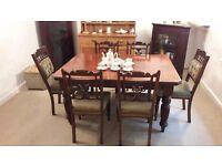 Victorian furniture; table and six matching chairs