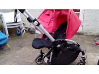 Lovely Red Buggaboo bee complete with cocoon and raincover for sale. Smoke and pet free home
