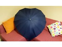 Used, great condition large navy blue umbrella in 'heart' shape design