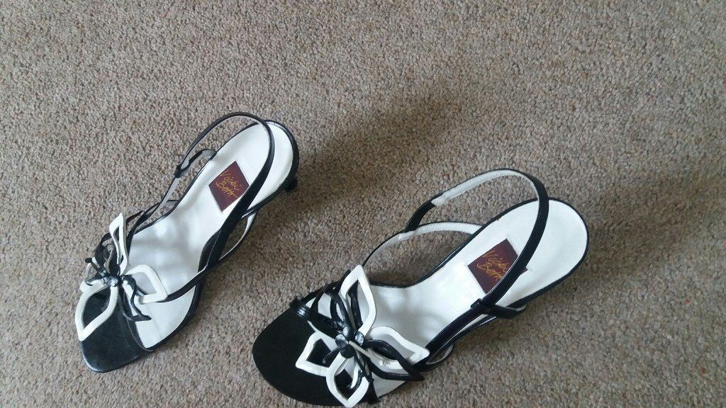 New, unworn black/white patent leather evening sandals