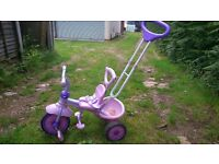 Girls pink trike with a canopy and a parent handle