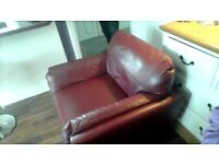 Tub style red leather armchair.
