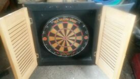 mounted darts board with doors good condition