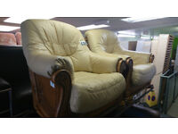 Pair of cream leather armchairs with wooden frames