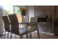 Harvey's Glass Dining Table & 4 Chairs