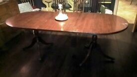 Extendable mahogany dining table.