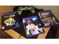 Boxed PlayStation 4, 2 controllers, 3 games and a turtle beach headset