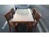 wooden dinning table and 4 chaires